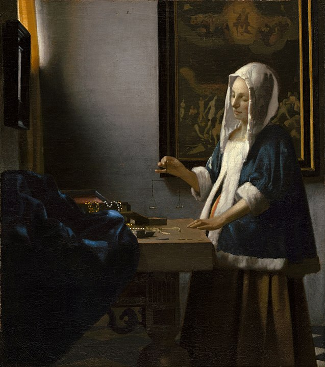 637px johannes vermeer   woman holding a balance   google art project